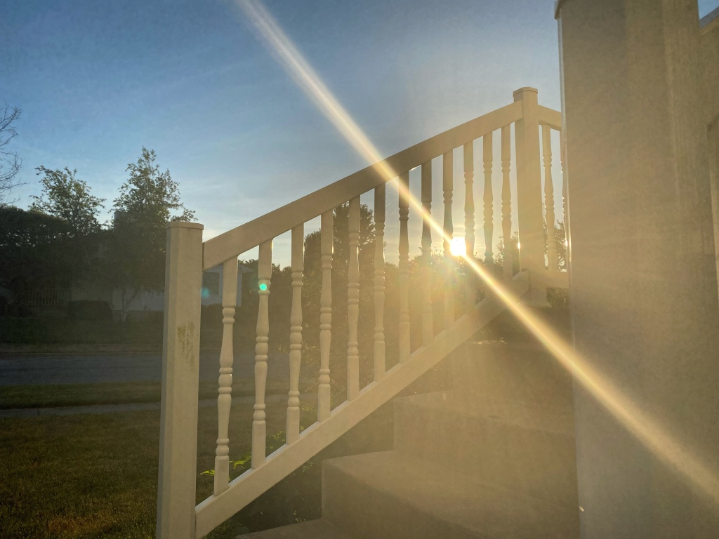 sunrise through the railings on my porch